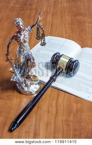 A Statuette Of Themis, The Constitution Of The Russian Federation And The Gavel