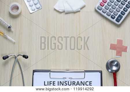 Top View Of Life Insurance Policy With Stethoscope, Hypodermic Syringe, Plaster, Gauze, Medicine, Ta