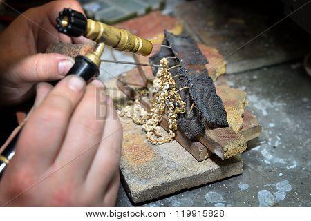 jeweler produces jewelry