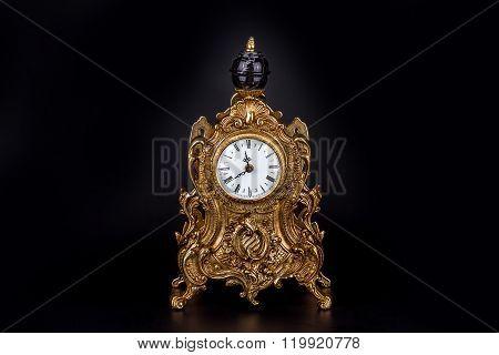 Antique Clock On Black Background