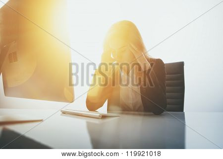 Photo of businesswoman in stress. She is tired and sitting at table modern office. White background,