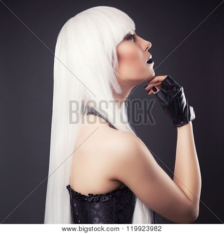 Beautiful Blonde Woman With Black Make-up And Accessories