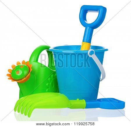 Toy bucket, rake and spade isolated on white background