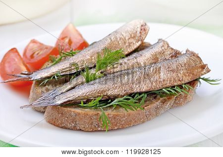 Sprats Sandwich And Tomatoes Slices