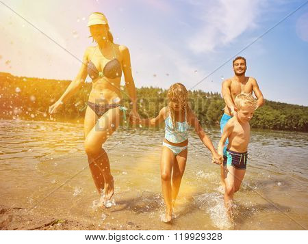 Happy family bathing on their holidays in summer