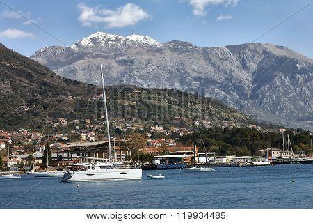 Mountain Lovcen peak and yacht