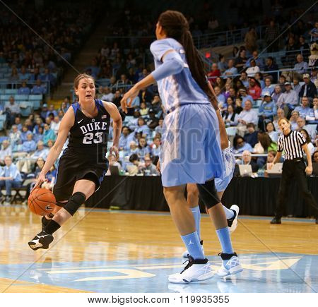 CHAPEL HILL, NC-FEB 28: Duke Blue Devils guard Rebecca Greenwell (23) dribbles the ball as UNC Tar Heels forward Hillary Summers (30) defends on February 28, 2016 at Carmichael Arena.