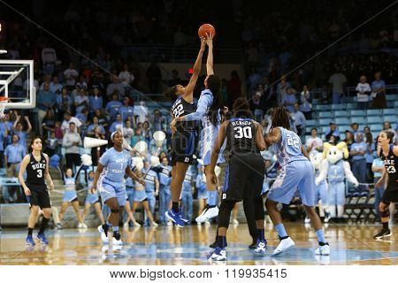 CHAPEL HILL, NC-FEB 28: Duke Blue Devils forward Oderah Chidom (22) and UNC Tar Heels forward Hillary Summers (30) jump for the ball on February 28, 2016 at Carmichael Arena.