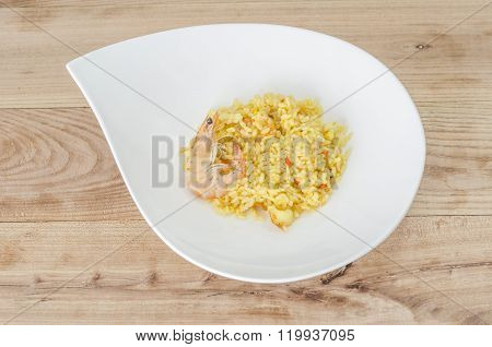 Paella, Typical Spanish Dish On White Background.