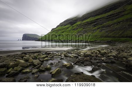 Risin and Kellingin sea stacks in the distance, Tjornuvik bay, Streymoy, Faroe Islands (Faroes), Den