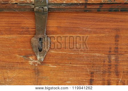 Closeup background texture photo of rustic weathered wooden box with metal hinge hasp lock