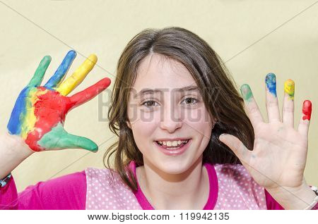 Girl Showing Her Hands Painted In Bright Colors.