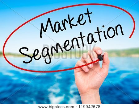 Man Hand Writing Market Segmentation With Black Marker On Visual Screen.