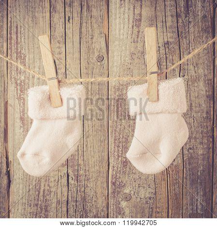 Baby socks hanging on twine