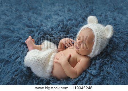 Newborn Baby Boy Wearing A White Bear Costume