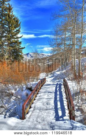A beautiful HDR image of bridge over a river at a ski resort in the Rockies Mountains