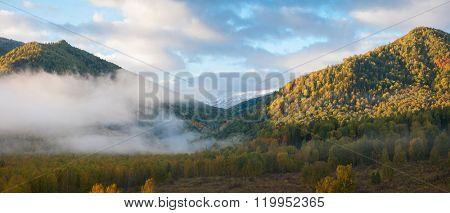 sunrise in autumn taiga and mountains