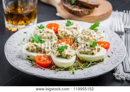 Deviled Eggs With Mushrooms, Mayonnaise And Cherry Tomatoes On Cress Sprouts