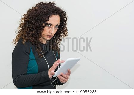 Modern Mature Woman, Angry, Use The Tablet.
