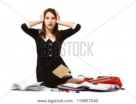 Beautiful schoolgirl with school supplies isolated on white