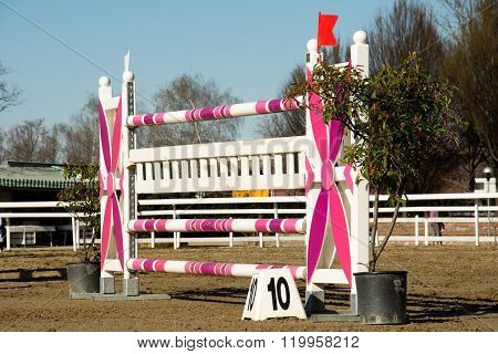Pink Hurdle In A Field