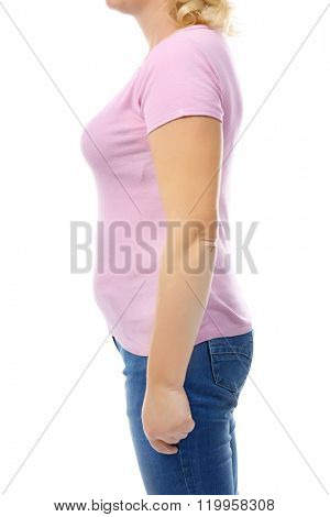 Chubby woman's body in pink tee-shirt and jeans isolated on white