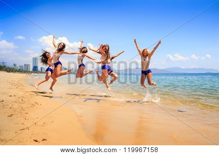 Cheerleaders Jump Synchronously Over Shallow Water Smile
