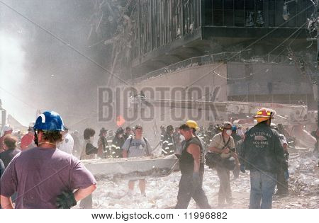 NEW YORK - SEPTEMBER 11:  Emergency personnel and journalists work near the area known as Ground Zero after the collapse of the Twin Towers September 11, 2001 in New York City.