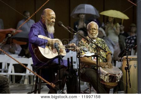 NEW YORK - JULY 23: Musician Richie Havens (L) and percussionist Daniel Ben Zebulon perform at Battery Park's Castle Clinton on July 23, 2009 in New York City.