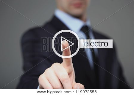 Businessman pressing play electro music button