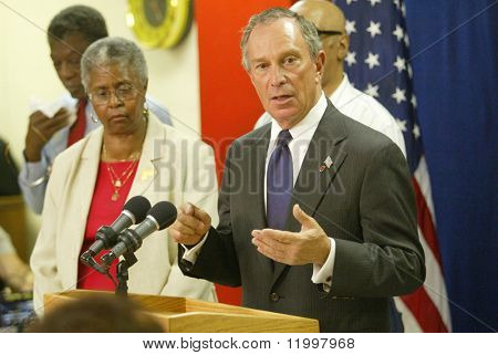 NEW YORK - AUGUST 15:  NYC Mayor Michael Bloomberg (C) speaks to the media about heat related issues affecting New Yorkers at the Wakefield Senior Center August 15, 2005 in Jamaica, New York.