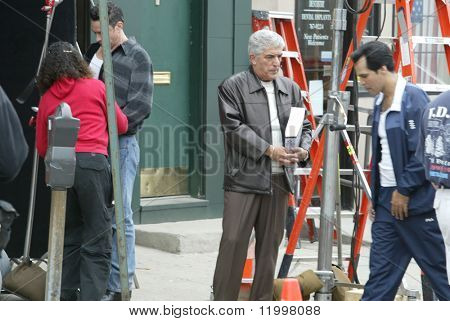 NEW YORK - MAY 15: Actor Frank Vincent (C) waits to film another scene of The Sopranos on May 15, 2003 in the Queens neighborhood of Whitestone, NY.