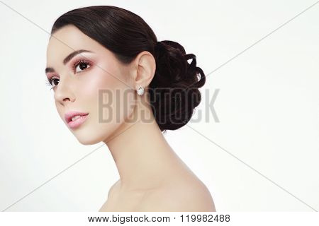 Portrait of young beautiful woman with stylish make-up and prom hairdo