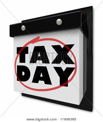 Tax Day - Words Circled On Wall Calendar