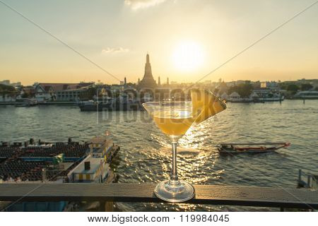 Pineapple Cocktail On Table In Rooftop Bar With Famous Place Background. Wat Arun ,bangkok ,thailand