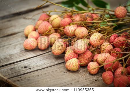 Red Litchi On Wooden Floor