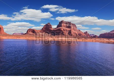 Lake Powell is surrounded by magnificent sandstone hills. A boat trip on a sunny day. Scenic huge artificial water basin of the Colorado River, USA
