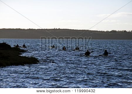 Kayakers In The Sea