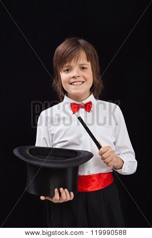Happy Magician Boy On Black Background