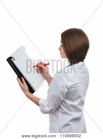 Doctor Girl Standing Sideways And Writes On The Tablet.