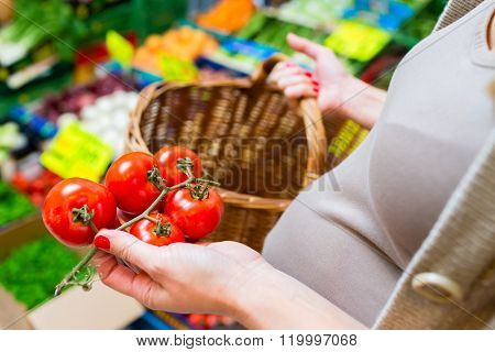 Woman shopping groceries on farmers market