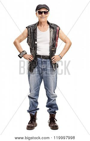 Full length portrait of a senior punk rocker looking at the camera and smiling isolated on white background