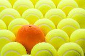 Macro Set of Brand New Tennis Balls and One Orange. poster