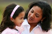 pic of mother daughter  - Mother and daughter together laughing while talking - JPG