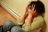 picture of teenage girl  - young teen holding head with a case of depression - JPG