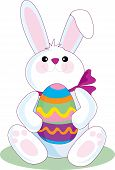 stock photo of easter eggs bunny  - the easter bunny holding a big easter egg - JPG