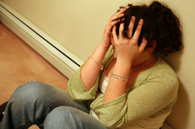 image of teenage girl  - young teen holding head with a case of depression - JPG