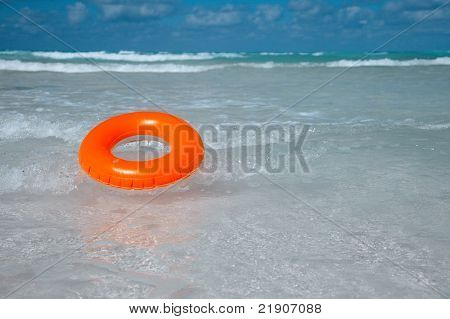 floating  ring on blue clear sea,  reflecting in the summer sun, shallow dof