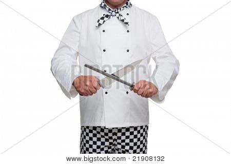 Photo of a chef in uniform sharpening his carving knife isolated on a white background.
