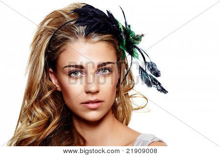 young woman portrait wearing beautiful vintage feather headband on long curly hair